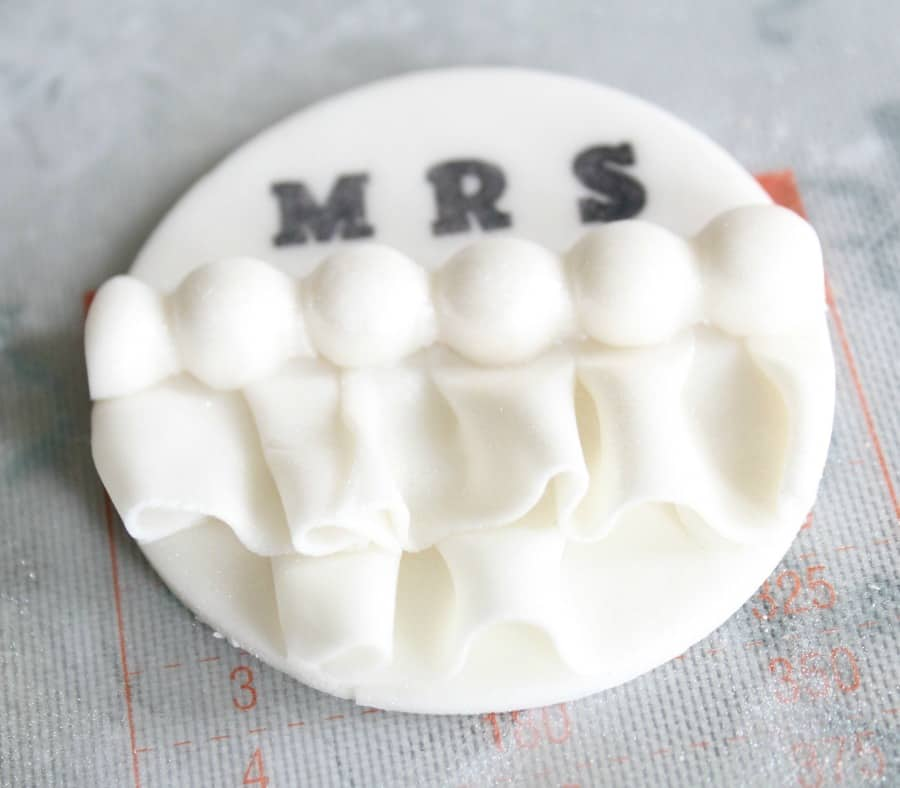 Dusting the cupcake toppers