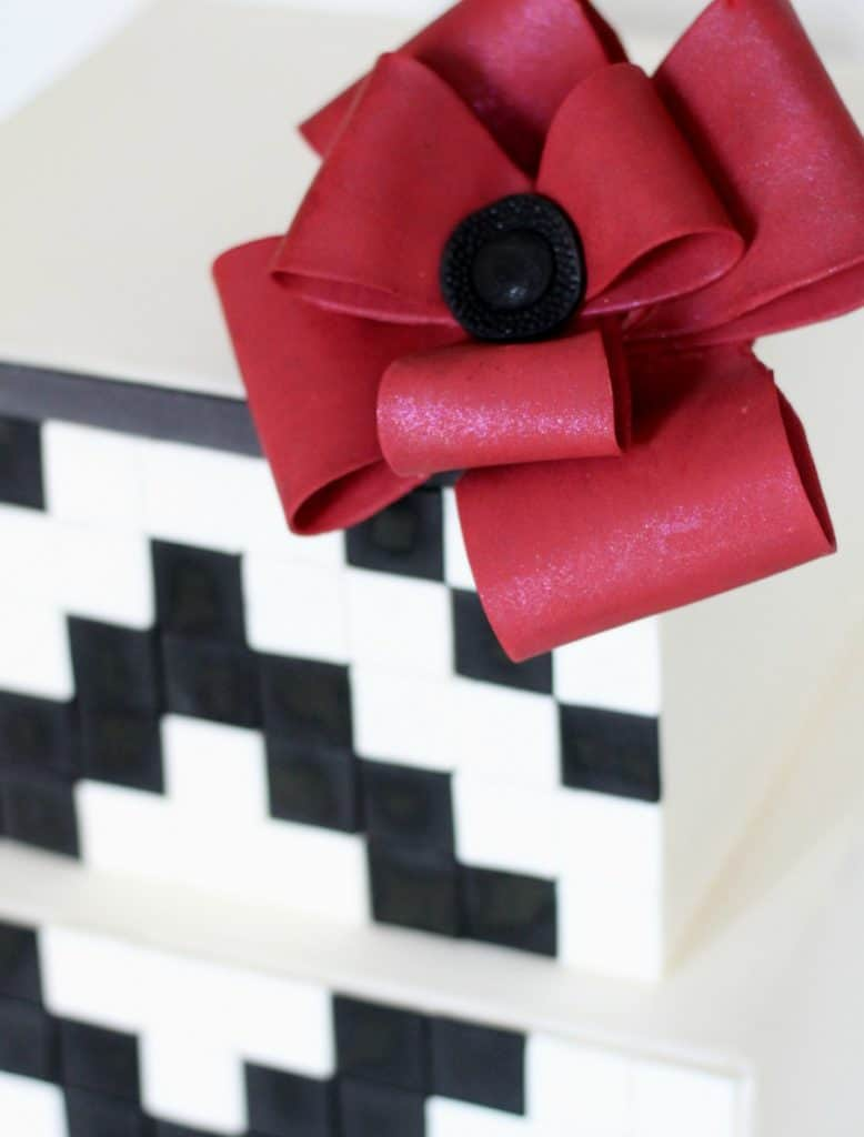 Fondant Looped Bow on top corner of geometric black and white cake